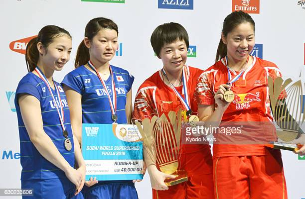 China's Chen Qingchen and Jia Yifan pose with their gold medals after winning the women's doubles of the Dubai World Superseries Finals on Dec 18...