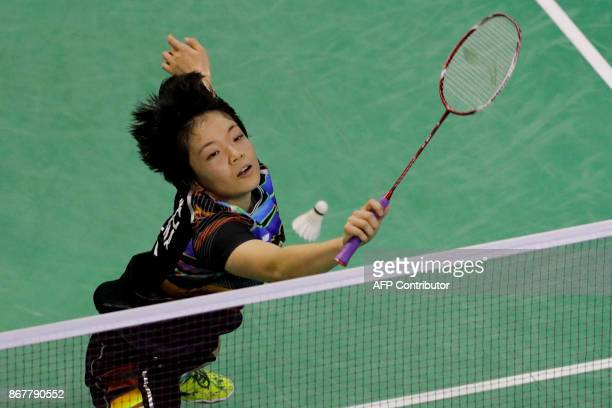 China's Chen Qingchen returns the ball during the Badminton Yonex French Open Mixed Doubles final badminton match on October 29 at the stade...
