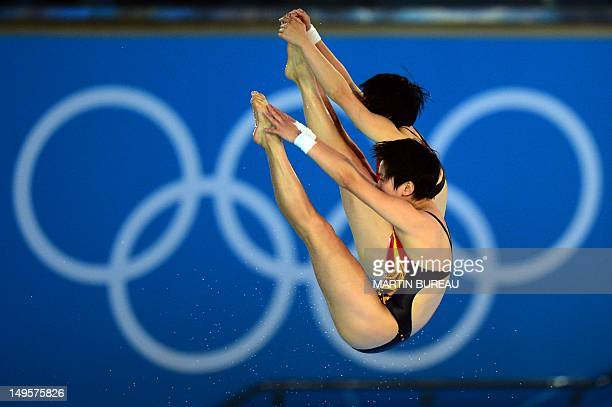 China's Chen Ruolin and Wang Hao compete in the women's synchronised 10m platform final at the London 2012 Olympic Games in London, on July 31, 2012....