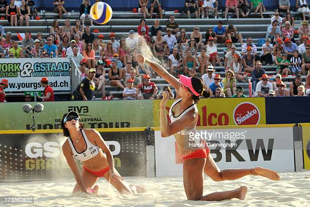 China's Chen Xue controls the ball as Xi Zhang looks on during the AntonelliAgatha v XueZhang Xi game as part of the FIVB Gstaad Grand Slam fourth...