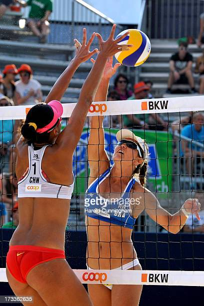 China's Chen Xue defends the ball as Brazils' Maria Antonelli attacks on during the AntonelliAgatha v XueZhang Xi game as part of the FIVB Gstaad...