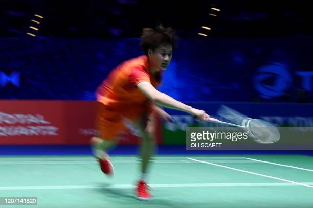 China's Chen Yu Fei returns to Japan's Nozomi Okuhara during their All England Open Badminton Championships women's singles semi-final match in...