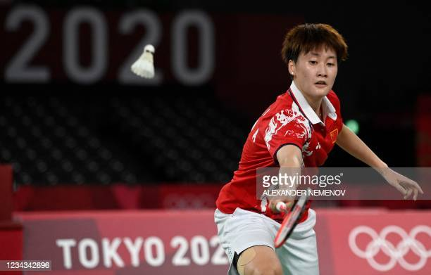 China's Chen Yufei hits a shot to China's He Bingjiao in their women's singles badminton semi-final match during the Tokyo 2020 Olympic Games at the...