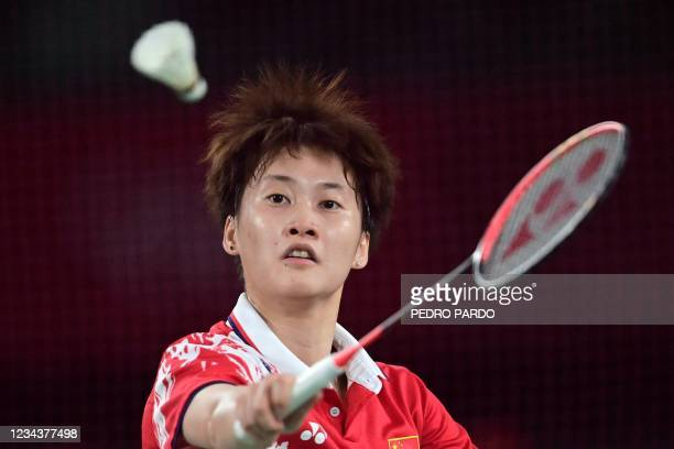 China's Chen Yufei hits a shot to Taiwan's Tai Tzu-ying in their women's singles badminton final match during the Tokyo 2020 Olympic Games at the...
