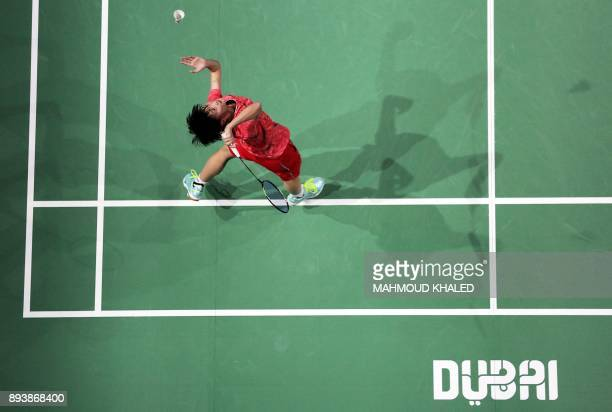 China's Chen Yufei returns a shot to India's Pusarla V Sindhu during their semifinal match during the Dubai Badminton World Superseries Finals in...