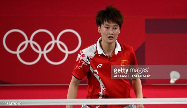 China's Chen Yufei watches the shuttlecock during a rally with Taiwan's Tai Tzu-ying in their women's singles badminton final match during the Tokyo...
