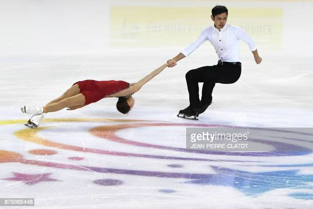 China's Cheng Peng and Yang Jin perform during the Ice Pairs short program event of the Internationaux de France ISU Grand Prix of Figure Skating in...