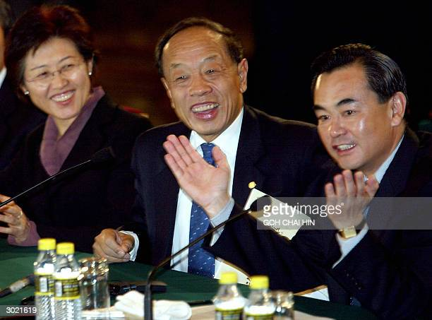 China's chief delegate Wang Yi applauses Chinese Foreign Minister Li Zhaoxing after Li delivered his closing address during the sixparty talks at the...