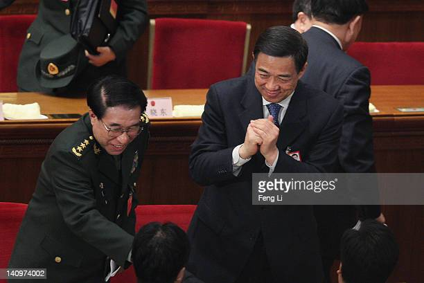 China's Chongqing Municipality Communist Party Secretary Bo Xilai makes an obeisance to a delegate after the third plenary meeting of the National...
