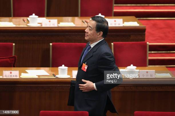 China's Chongqing Municipality Communist Party Secretary Bo Xilai leaves after the third plenary meeting of the National People's Congress at The...