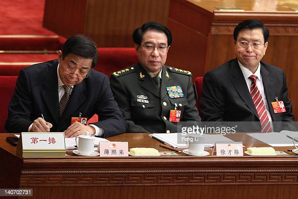 China's Chongqing Municipality Communist Party Secretary Bo Xilai attends the opening ceremony of the National People's Congress at the Great Hall of...