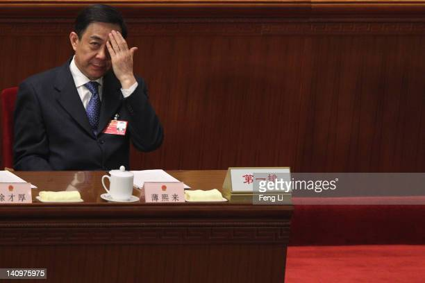 China's Chongqing Municipality Communist Party Secretary Bo Xilai attends the third plenary meeting of the National People's Congress at The Great...