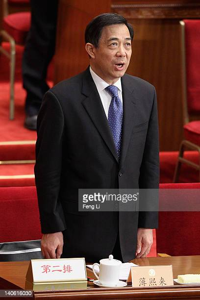 China's Chongqing Municipality Communist Party Secretary Bo Xilai stands to sing the national anthem during the opening ceremony of the Chinese...