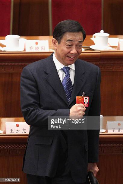 China's Chongqing Municipality Communist Party Secretary Bo Xilai gestures to other delegates after the third plenary meeting of the National...