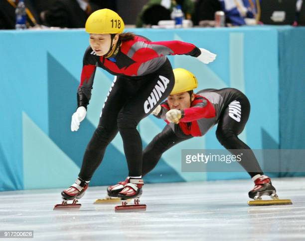 China's Chunlu Wang is pushed by teammate Dandan Sun during the women's 3000m relay semifinals of the short track speed skating at the Olympic Ice...