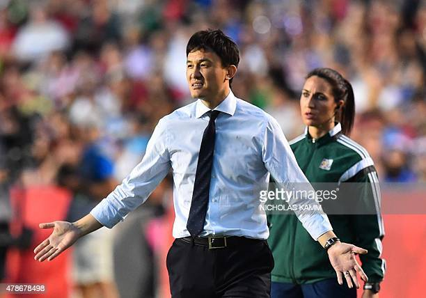 China's coach Hao Wei gestures during a 2015 FIFA Women's World Cup quarterfinal match between the US and China at Lansdowne Stadium in Ottawa...
