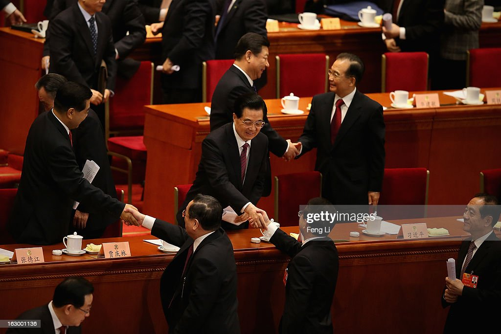 China's Communist Party Chief Xi Jinping (Top) shakes hands with China's Premier Wen Jiabao (Right) as China's President Hu Jintao (Center) shakes hands with delegate Ling Jihua (Below Right), Chairman of the Chinese People's Political Consultative Conference Jia Qinglin (Left) shakes hands with delegate Yu Zhengsheng (Below Left) after the opening session of the Chinese People's Political Consultative Conference in Beijing's Great Hall of the People on March 3, 2013 in Beijing, China.