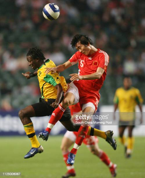 China's Dai Lin beats Jamaica's Kevin Bryan to the ball during the China vs. Jamaica match in the final of Lunar New Year Cup at Hong Kong Stadium....
