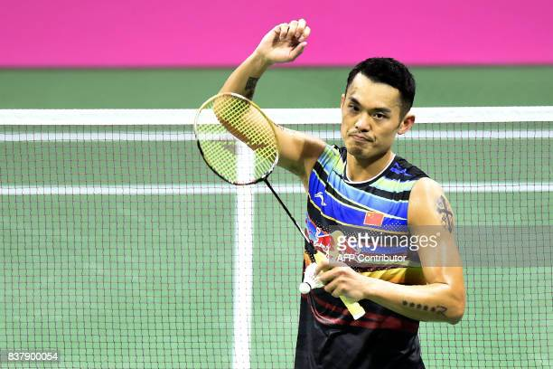 China's Dan Lin celebrates victory over Denmark's Emil Holst after their round two mens's singles match during the 2017 BWF World Championships of...