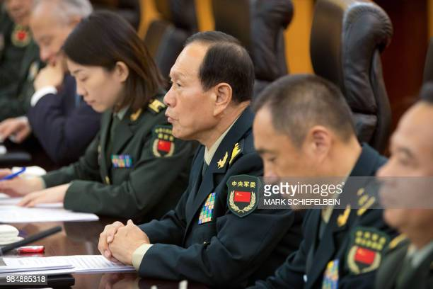 China's Defence Minister Wei Fenghe talks with US Defence Secretary Jim Mattis during their meeting at the Bayi building in Beijing on June 27 2018