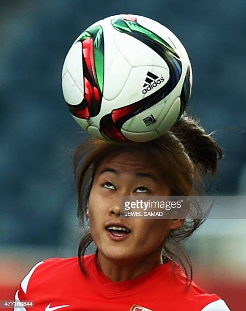 China's defender Wu Haiyan heads a ball during a training session at the Winnipeg Stadium on the eve of their Group A football match of the 2015 FIFA...