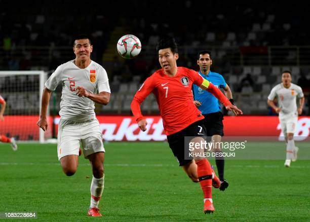 China's defender Yiming Liu fights for the ball with South Korea's forward Heungmin Son during the 2019 AFC Asian Cup group C football match between...