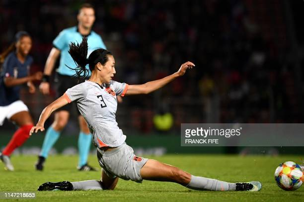 China's defender Yuping Lin plays the ball during the friendly football match between France and China on May 31, 2019 at Dominique-Duvauchelle...