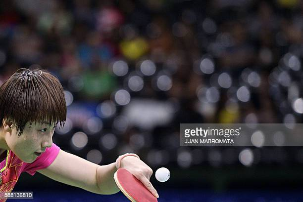 TOPSHOT China's Ding Ning hits a shot against North Korea's Kim Song I in their women's singles semifinal table tennis match at the Riocentro venue...