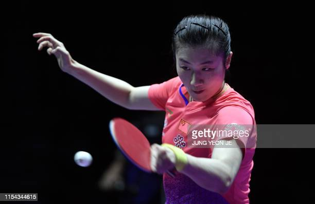 China's Ding Ning returns the ball against compatriot Chen Meng during the women's singles final match at 2019 ITTF World Tour Korea Open table...