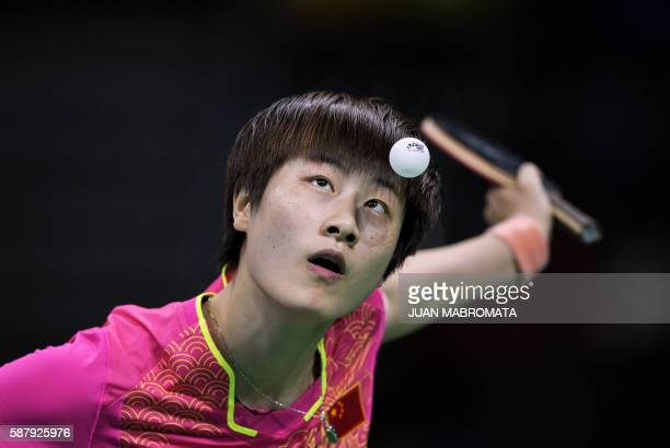 TOPSHOT China's Ding Ning serves against North Korea's Kim Song I in their women's singles semifinal table tennis match at the Riocentro venue during...