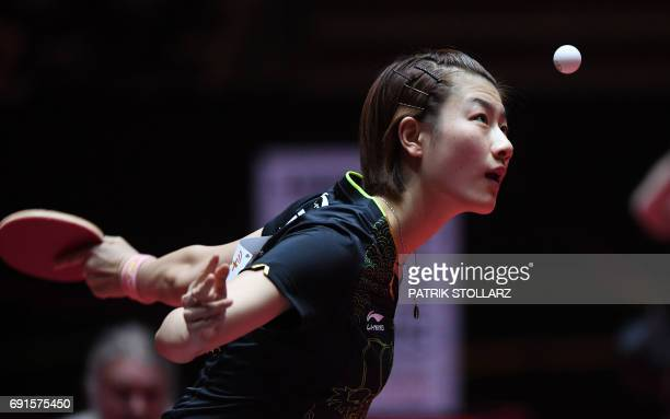 TOPSHOT China´s Ding Ning vies for the ball during a quarter final match against Japan´s Kasumi Ishikawa during the WTTC World Table Tennis...