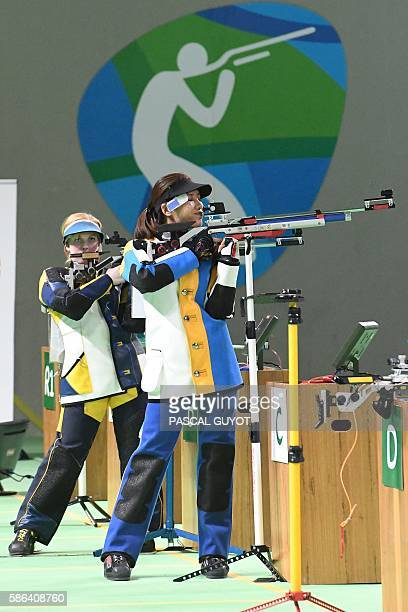 China's Du Li and USA's Virginia Thrasher compete in the women's 10m air rifle shooting final at the Rio 2016 Olympic Games at the Olympic Shooting...