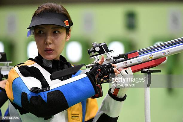 China's Du Li competes in the women's 10m air rifle shooting qualifications at the Rio 2016 Olympic Games at the Olympic Shooting Centre in Rio de...