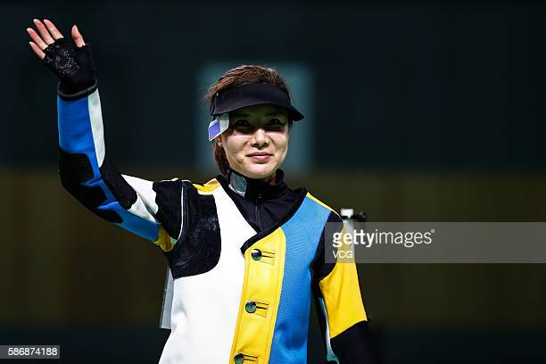 China's Du Li waves hand after the women's 10m air rifle shooting final during the Rio 2016 Olympic Games at the Olympic Shooting Centre on August 6...