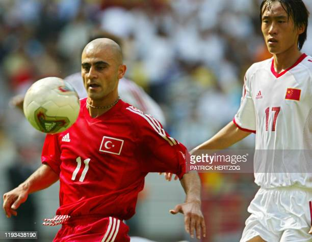 China's Du Wei chases Turkey's Hasan Sas for the ball13 June 2002 at the Seoul World Cup Stadium in Seoul during first round Group C action between...