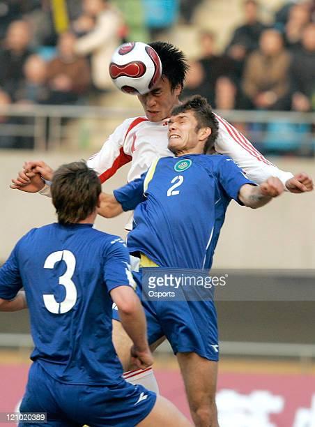 China's Du Wei vies with Kazakstan's Azovskiy Egor and Kuchma Alekxandr during a friendly match in Suzhou China on February 7 2007 China won 21