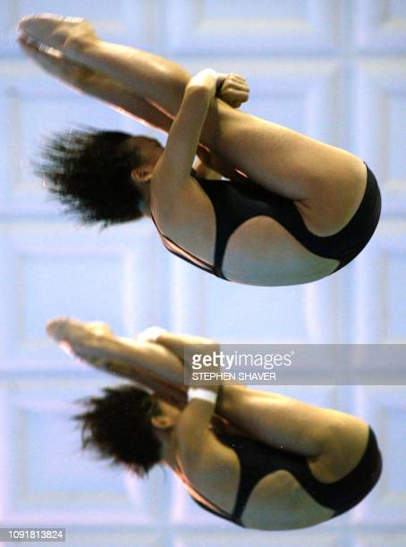 China's Duan Qing and Li Ting perform their dive routine during the women's synchronized diving finals 09 October 2002 during the 14th Asian Games in...