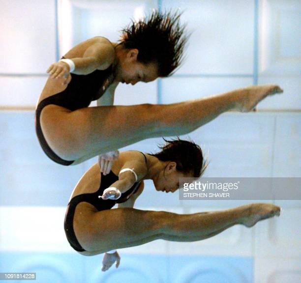 China's Duan Qing and Lu Ting perform their dive routine during the women's synchronized diving finals 09 October 2002 at the 14th Asian Games in...