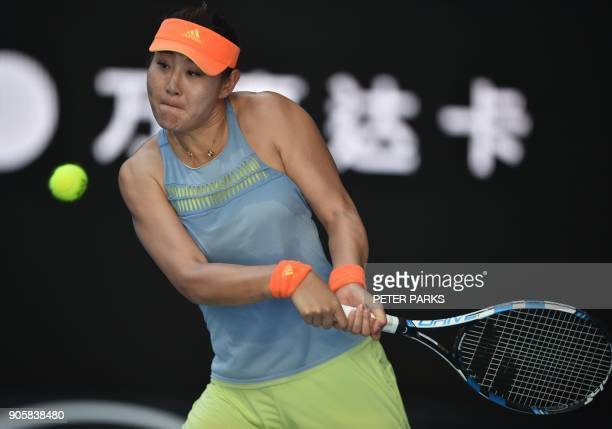 China's Duan YingYing hits a return against Latvia's Jelena Ostapenko during their women's singles second round match on day three of the Australian...