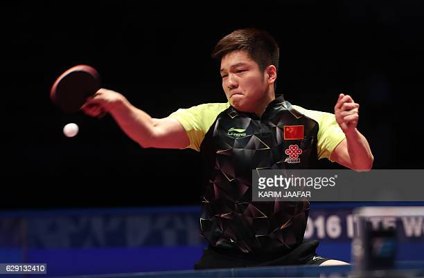 China's Fan Zhendong competes against China's Ma Long during their men's singles final match as part of the Qatar 2016 ITTF World Tour Grand Finals...