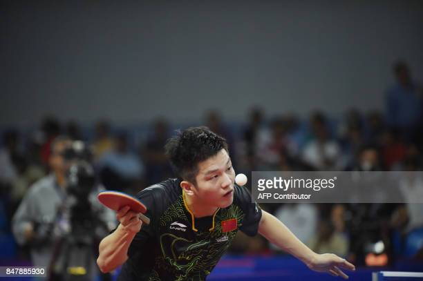 TOPSHOT China's Fan Zhendong plays against South Korea's Lee Sangsu in the Singles semifinals during the 30th Asian Table Tennis Cup 2017 in...