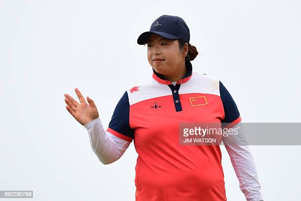 China's Feng Shanshan celebrates her bronze medal in the final day of the Women's individual stroke play at the Olympic Golf course during the Rio...
