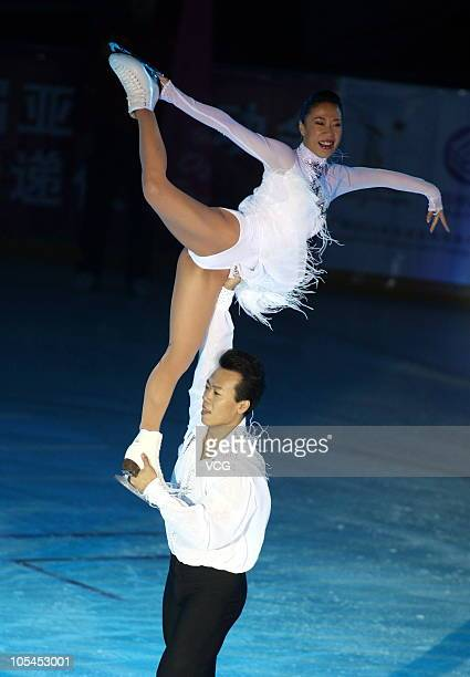 China's figure skaters Shen Xue and Zhao Hongbo performs during a 2010 Guangzhou Asian Games Torch Relay Ceremony at Harbin Baqu Stadium on October...