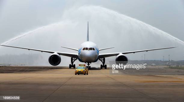 China's first Boeing 787 Dreamliner delivered to China Southern Airlines receives a ceremonial water salute upon arrival at the airport in Guangzhou...