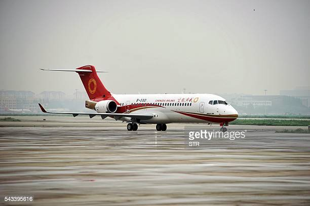 China's first domestic regional jet ARJ21700 arrives at Shanghai Hongqiao Airport after making its first flight from Chengdu to Shanghai on June 28...