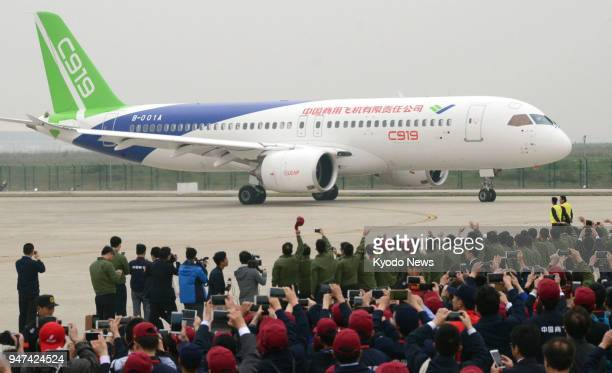 A C919 China's first domestically built jetliner completes its maiden flight at Shanghai Pudong International Airport on May 5 2017 ==Kyodo