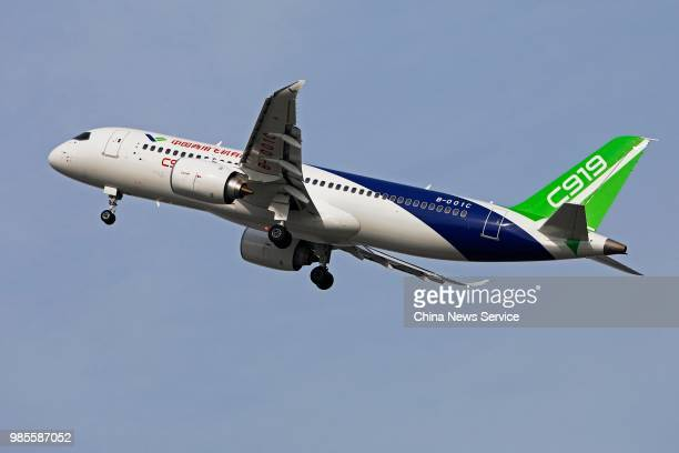 China's first domestically made C919 passenger jet takes off from the Shanghai Pudong International Airport for a test flight on June 26 2018 in...