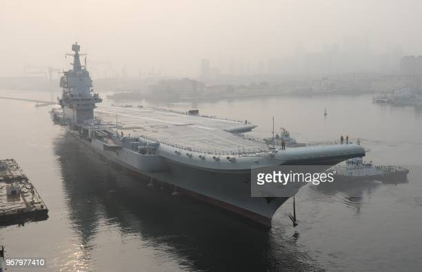 China's first domestically manufactured aircraft carrier known only as Type 001A leaves port in the northeast city of Dalian early on May 13 2018...
