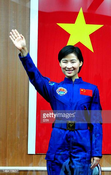 China's first female astronaut Liu Yang waves during a press conference at the Jiuquan space base in north China's Gansu province June 15 2012 As a...