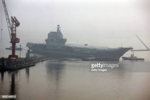 China's first homebuilt aircraft carrier sets out from a port of Dalian DSIC Shipyard for sea trials on May 13 2018 in Dalian Liaoning Province of...
